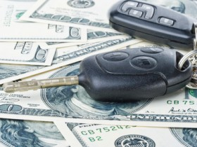 Car keys and money on a white background